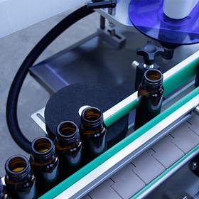 Etiquetadora automática de botellas redondas verticales